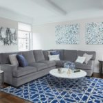 grey sectional with blue rug