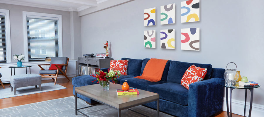blue sectional with grey rug